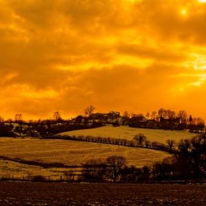 Paysage neigeux et coucher de soleil par Stéphane Thirion